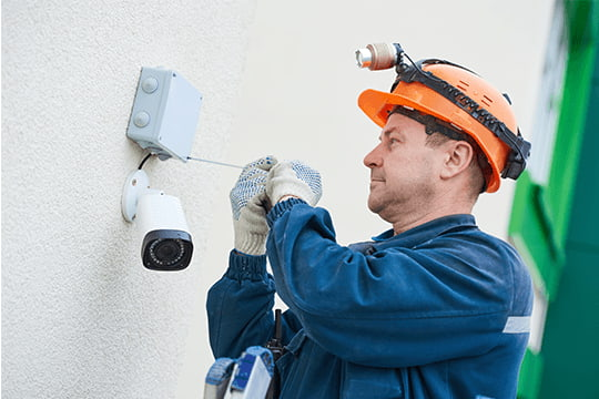 field service technician working on cctv camera